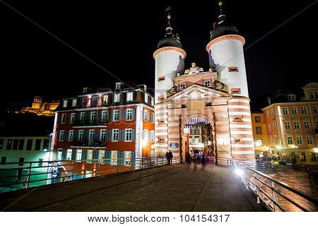 Gates and towers on Alte Brucke during night