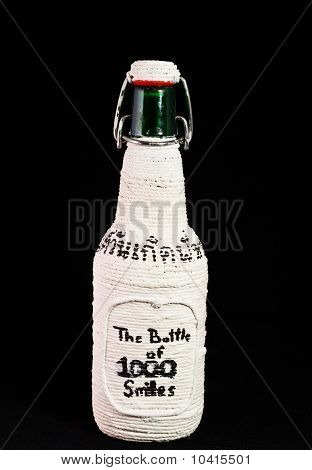 Bottle Wrapped In White String