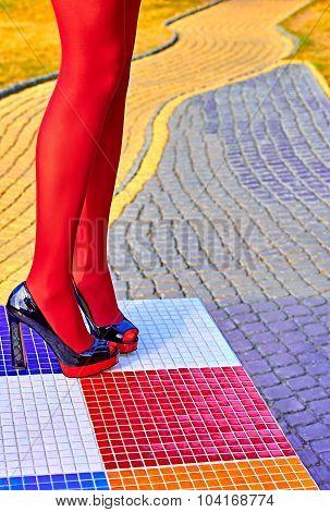 Fashion womens sexy legs, heels. Vivid multicolored geometry