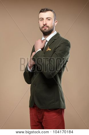 Young Man In A Green Suit And Tie