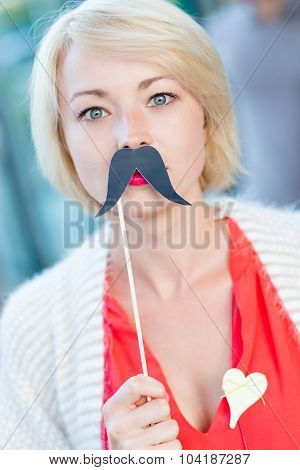 Woman with fake mustache.