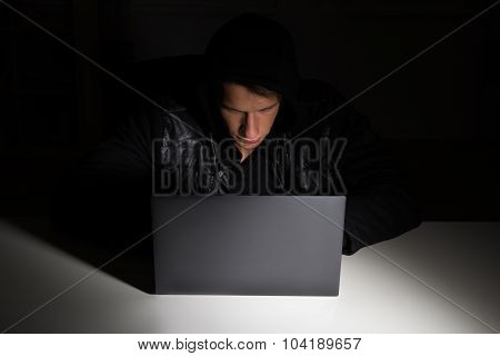 Hacker Stealing Data From Laptop