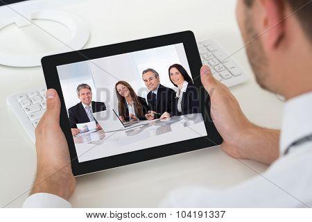 Businessman Videoconferencing With Digital Tablet