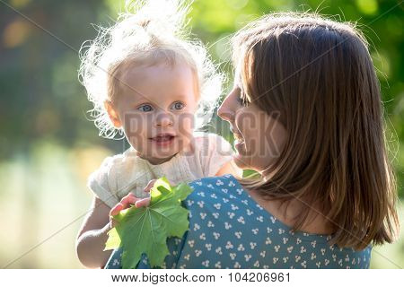 Mom And Toddler Girl Playing