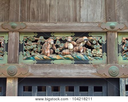 A carving of Three wise monkey in Nikko, Japan.