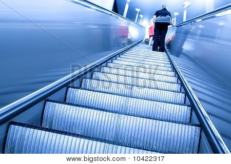 high-speed blue moving escalator inside shopping mall poster