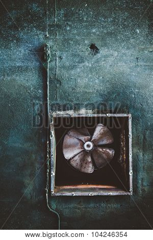 Abandoned air conditioning duct and rusted fan