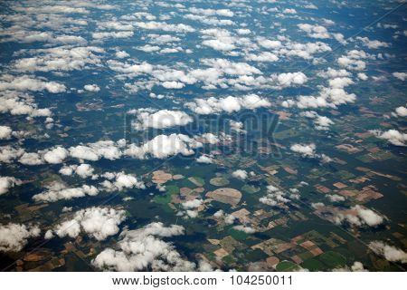 A unique view of Florida USA as seen from high above the clouds, through the window of a Jet Airplane. Florida is known for Alligators, Swamps, Sandy Beaches and is an international vacation spot
