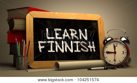 Hand Drawn Learn Finnish Concept  on Chalkboard. Blurred Background. Toned Image. poster