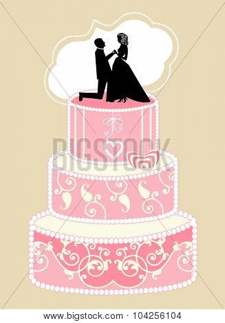 Tiered wedding cake with bride and groom topper