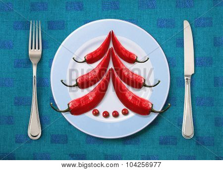 Christmas dish on white plate with knife and fork