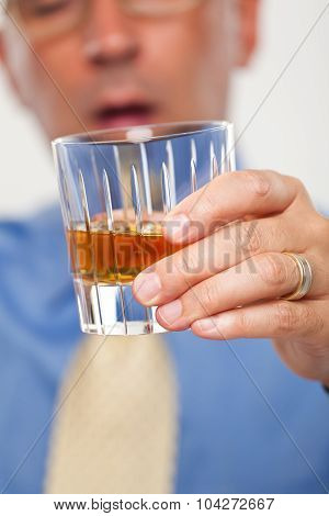 Close up of a drink being held by a man