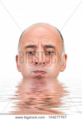 Man holding his breath as he is about to drown in water