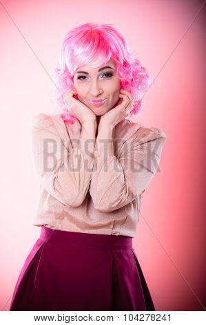 Portrait woman with pink wig creative visage makeup posing on gray background poster