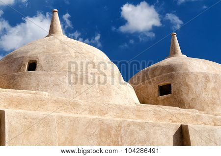 Jami al-Hamoda Mosque located in the town of Jalan Bani Bu Ali Sultanate of Oman with its unique structure of 52 domes and a falaj used for ablutions running through the courtyard. poster