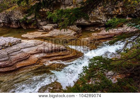 The Maligne River as it flows through the deep gorges of the Maligne Canyon in Jasper National Park in Alberta Canada poster