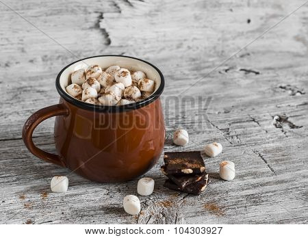 Hot Chocolate With Marshmallows In A Ceramic Cup On Bright Wooden Surface