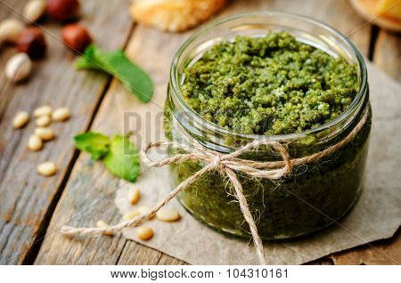 Basil mint hazelnuts pistachios almonds pine nuts pesto. poster