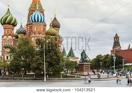 Tourists And Townspeople At The Intercession Cathedral On The Red Square.