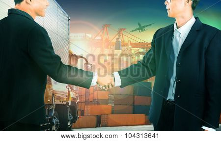 Two Business Man Shaking Hand Against Container Truck In Shipping Port ,container Dock And Freight C