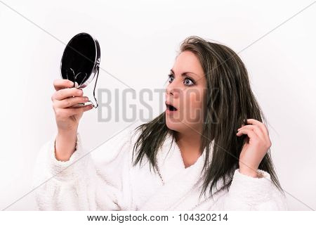brown haired woman looking shocked at herself in a mirror while wearing a bathrobe poster