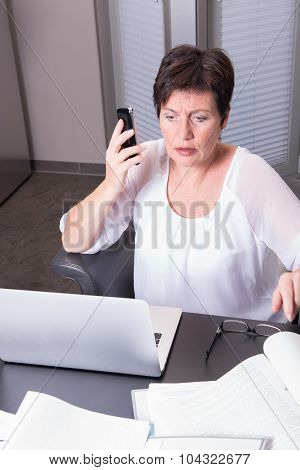 Attractive Woman In Her Home Office Overworked