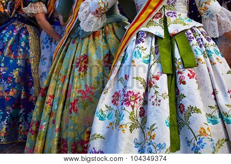 Unknown falleras dress from Valencia Fallas fest in a row at Spain