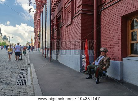 MOSCOW, RUSSIA - AUGUST 12, 2012. Actor in the image of Brezhnev near the Kremlin building. Leonid Ilyich Brezhnev was the General Secretary of the Central Committee of the Communist Party of the Soviet Union, presiding over the country