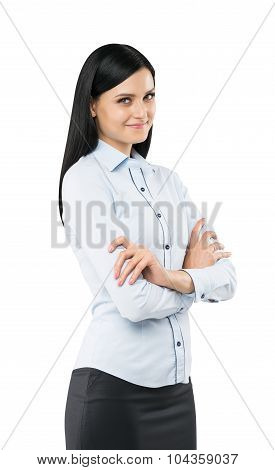 A Side View Of A Beautiful Smiling Lady With Crossed Hands. The Brunette Is Dressed In Formal Clothe