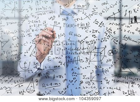 Quantitative Analyst Is Drawing Different Math Formulas On The Glass Screen. A Concept Of Profession