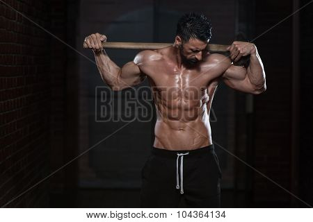Man With Hammer Showing His Well Trained Body