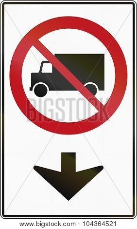 Canadian traffic sign prohibiting thoroughfare of lorries on the lane. This sign is used in Quebec. poster