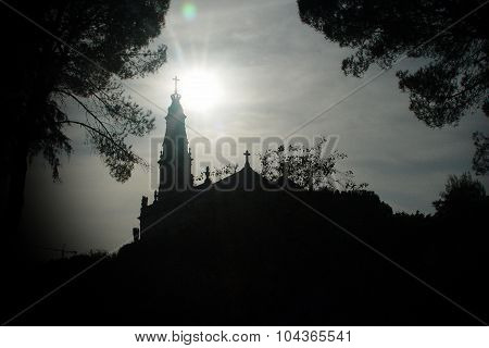 Fatima sanctuary silhouette framed by trees silhouette poster