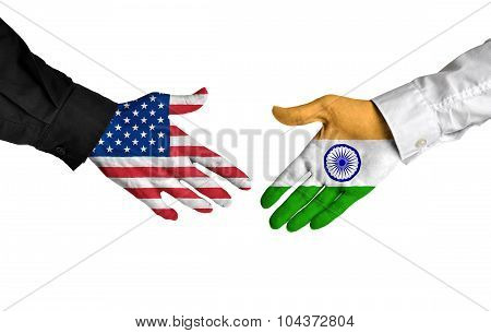 United States and India leaders shaking hands on a deal agreement