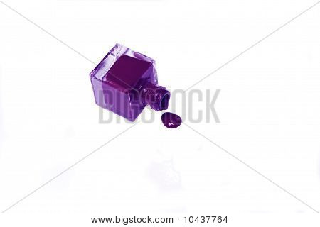 Violet Nail Polish Bottle With Splatters Isolated On White Background.