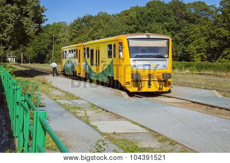 Yellow two-car train in Railway station Kutna Hora mesto