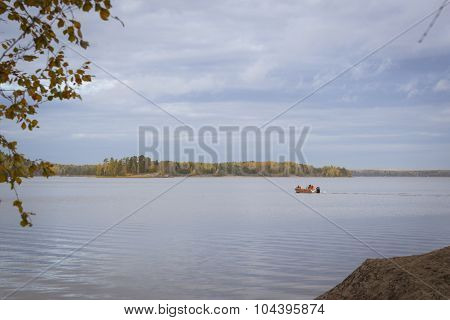 Fishermen sail on a boat in the Bay of Protective