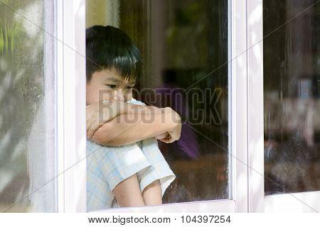 Boy Sit Beside Window