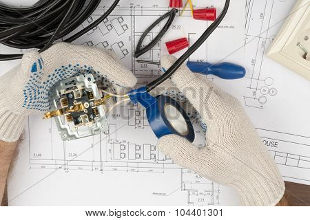 Mans hands fixing socket with adhesive tape on draft background poster