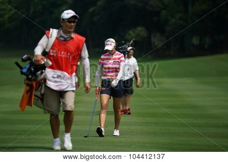 KUALA LUMPUR, MALAYSIA - OCTOBER 09, 2015: LPGA golfers and caddy walk on the fairway of the Kuala Lumpur Golf & Country Club during the 2015 Sime Darby LPGA Malaysia golf tournament.