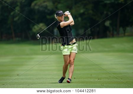 KUALA LUMPUR, MALAYSIA - OCTOBER 09, 2015: England's Melissa Reid plays from 6th hole fairway of the Kuala Lumpur Golf & Country Club at the 2015 Sime Darby LPGA Malaysia golf tournament.