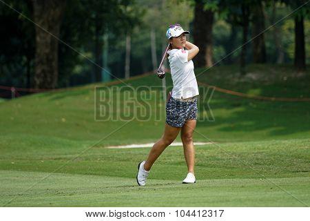 KUALA LUMPUR, MALAYSIA - OCTOBER 09, 2015: New Zealand's Lydia Ko plays her shot on the sixth hole fairway of the Kuala Lumpur Golf & Country Club at the 2015 Sime Darby LPGA Malaysia golf tournament.