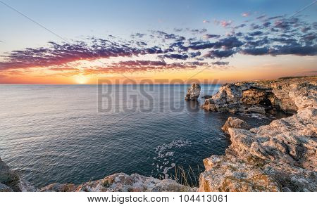 Beautiful Seascape. Sea And Rock At The Sunrise. Nature Composition.