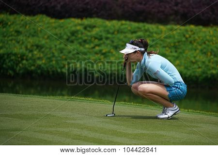 KUALA LUMPUR, MALAYSIA - OCTOBER 09, 2015: Germany's Sandra Gal lines her putt at the 18th hole green at the KL Golf & Country Club at the 2015 Sime Darby LPGA Malaysia golf tournament.