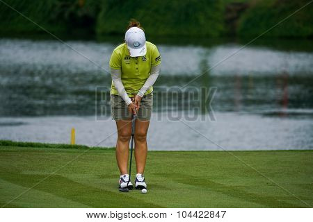 KUALA LUMPUR, MALAYSIA - OCTOBER 09, 2015: Japan's Mika Miyazato prepares her putt at the 18th hole green at the KL Golf & Country Club at the 2015 Sime Darby LPGA Malaysia golf tournament.