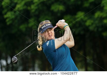 KUALA LUMPUR, MALAYSIA - OCTOBER 10, 2015: England's Charley Hull tees off at the sixth hole of the KL Golf & Country Club on Round 3 day at the 2015 Sime Darby LPGA Malaysia golf tournament.