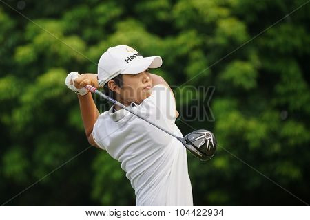 KUALA LUMPUR, MALAYSIA - OCTOBER 10, 2015: Japan's Haru Nomura tees off at the sixth hole of the KL Golf & Country Club on Round 3 day at the 2015 Sime Darby LPGA Malaysia golf tournament.