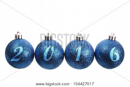 Four Blue Spangled Christmas Balls Arranged In The Year 2016