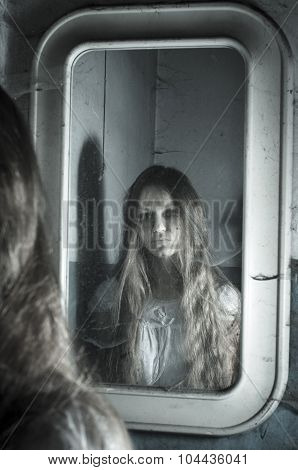 Horror girl in the mirror