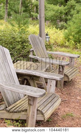 Adirondack chairs in a park